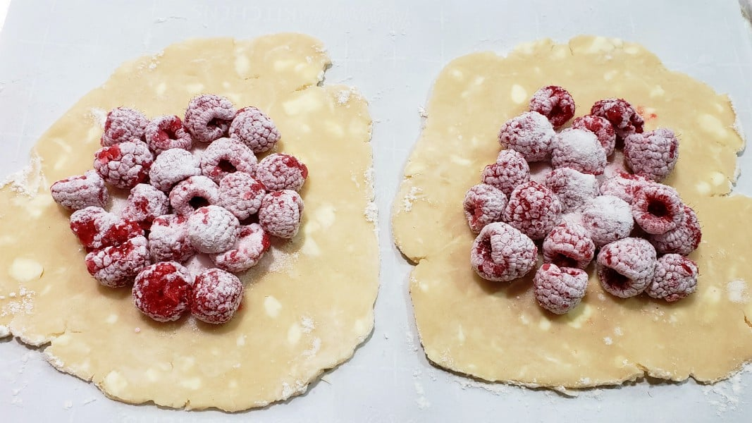 raspberry mixture spooned into centers of pie dough circles