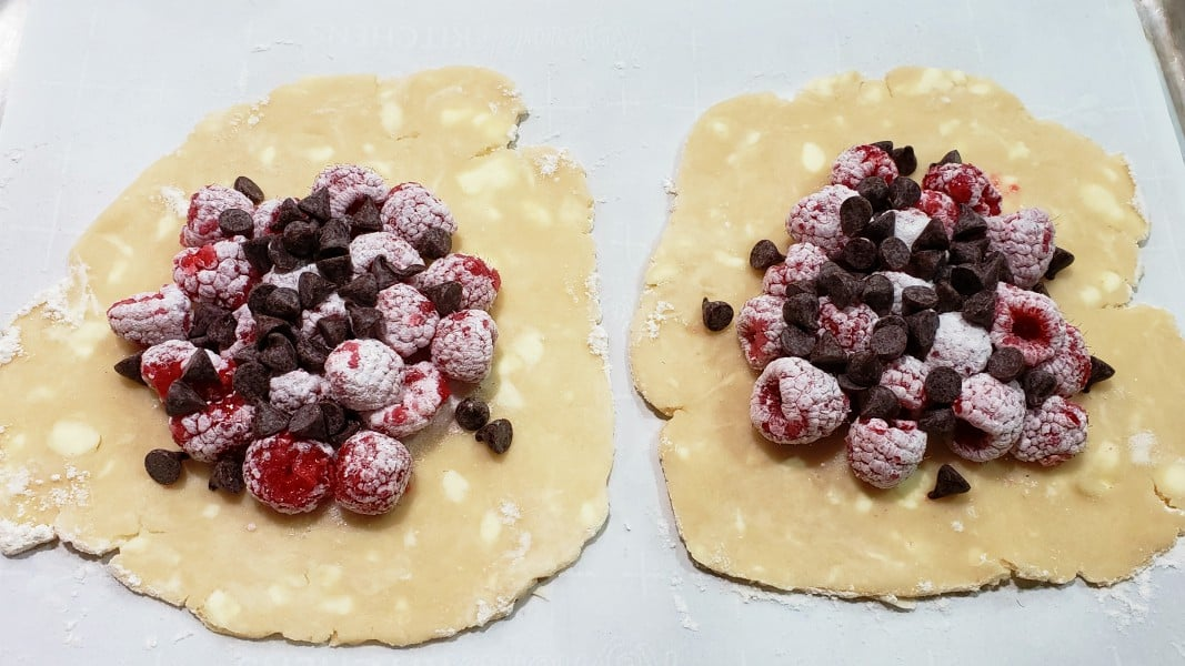 chocolate chips added on top of raspberry mixture
