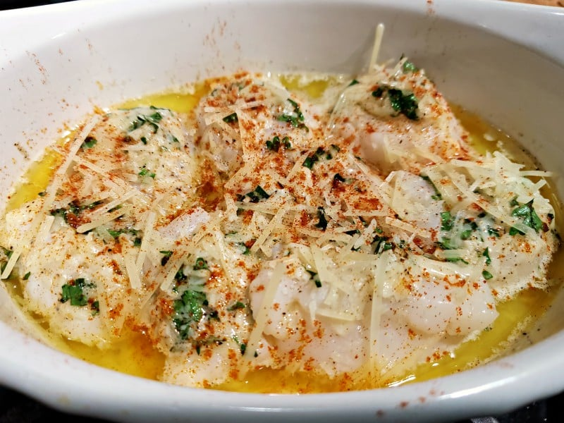 Parmesan cheese and paprika sprinkle on top of baked scallops