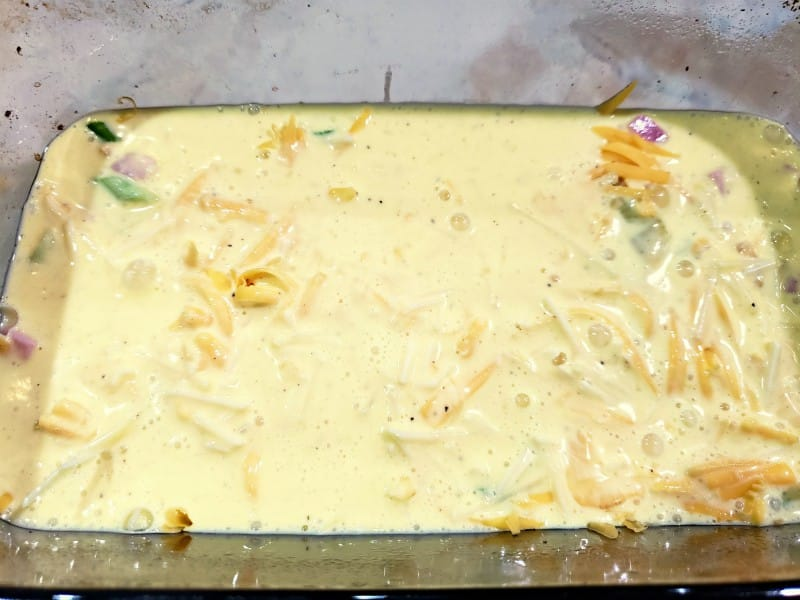 egg mixture added to the layered loaf pan ingredients