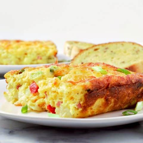 Ham and Cheddar Hash Brown Quiche on a plate with toast