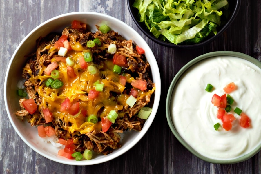 Chicken Taco Bowl, sour cream, and lettuce