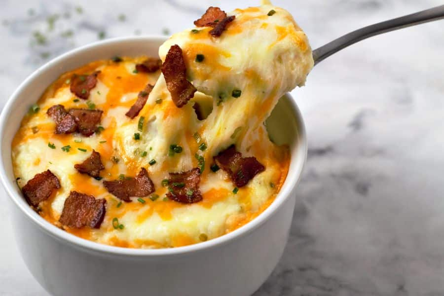 Mashed Potato Casserole with a spoon pulling a bite out