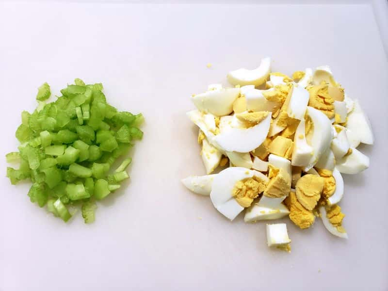 diced celery and chopped egg on a cutting board