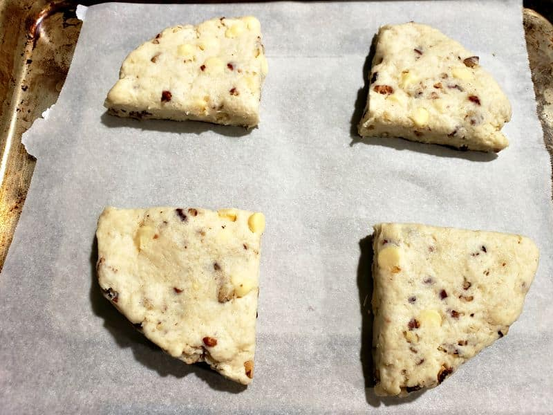 4 butter pecan scones on a baking tray