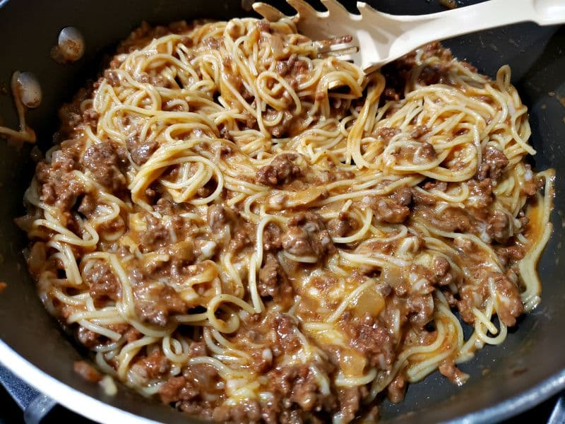 egg and cheese mixture added to pasta and meat sauce