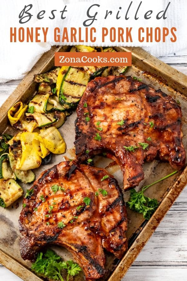 two grilled honey garlic pork chops and grilled zucchini