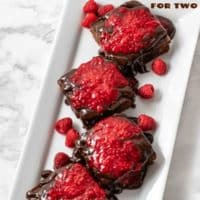 brownies with raspberry sauce and chocolate ganache for two