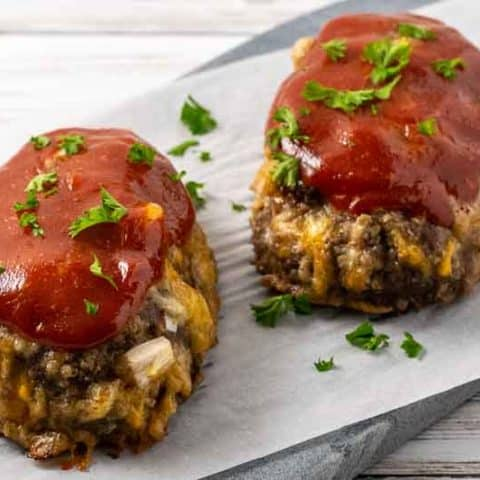 two little meatloaves on a cutting board