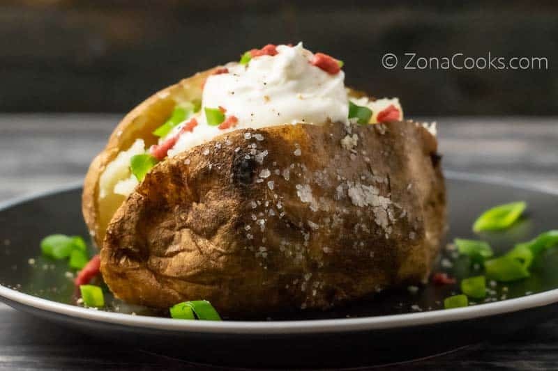 a salted crispy baked potato loaded with toppings