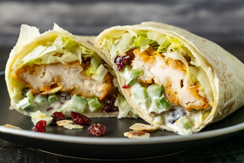 cranberry almond chicken salad wrap on a plate
