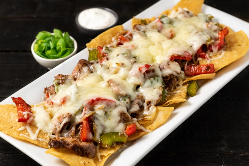 steak fajita nachos on a platter