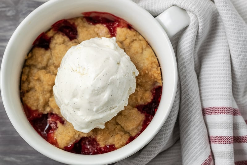 strawberry cobbler with a scoop of ice cream