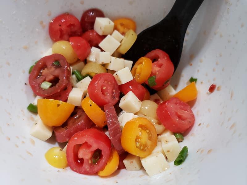 Italian tomato salad mixed in a bowl
