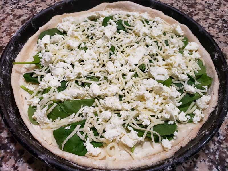 goat cheese sprinkled over pizza
