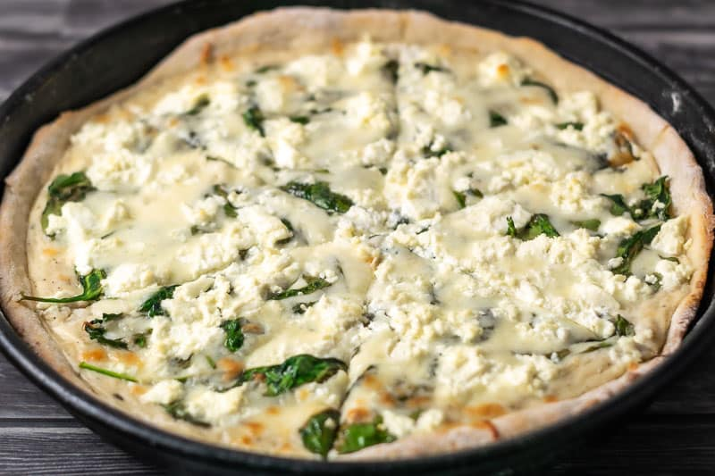 Goat Cheese and Spinach Pizza cut into slices