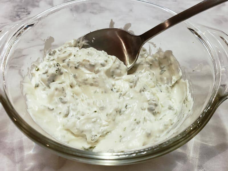 cream cheese mixed in a bowl with chives