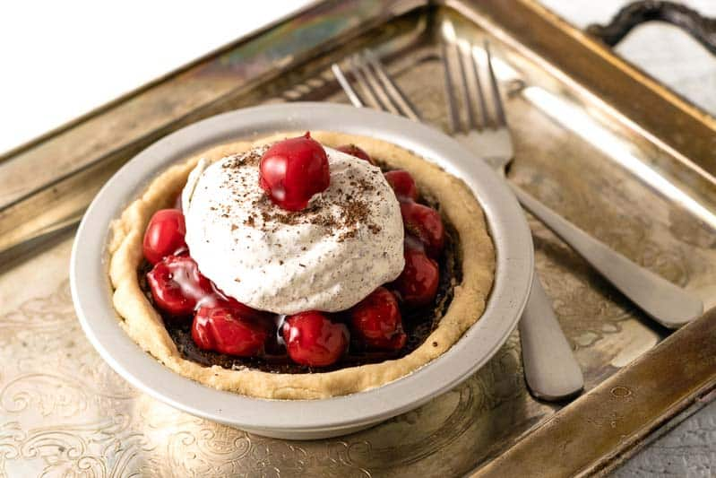 black forest pie on a tarnished tray with two forks