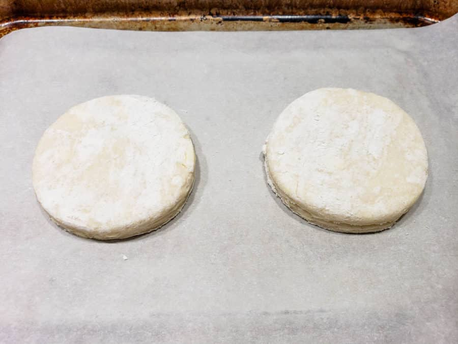 two round biscuits on a baking tray
