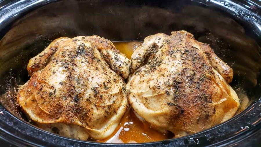 two cornish hens in a crockpot after cooking 8 hours