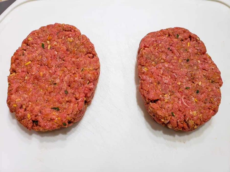 ground beef mixture formed into two ovals