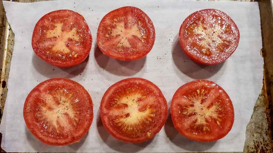 non-stick spray, salt, and pepper on 6 half tomatoes