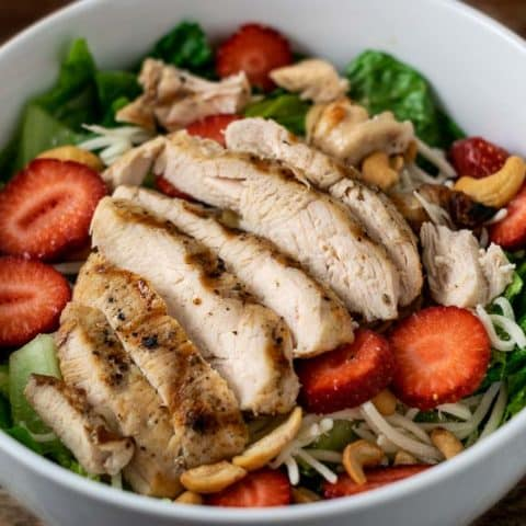 Chicken Strawberry Salad and Poppy Seed Dressing in a bowl