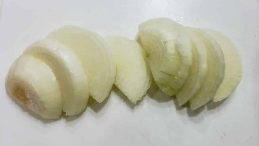 onion sliced on a cutting board