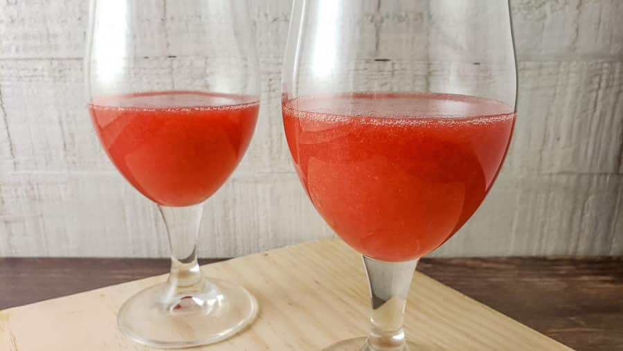 strawberry rum mixture in two glasses