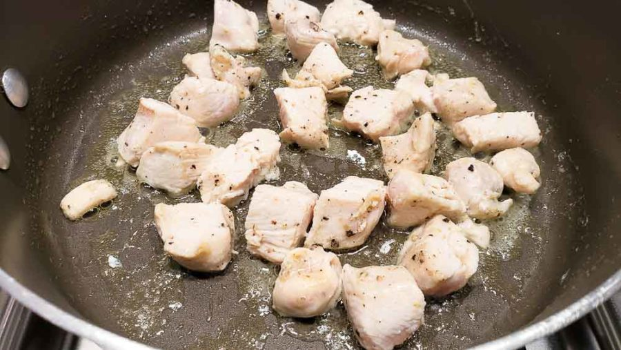 diced chicken cooking in a pan