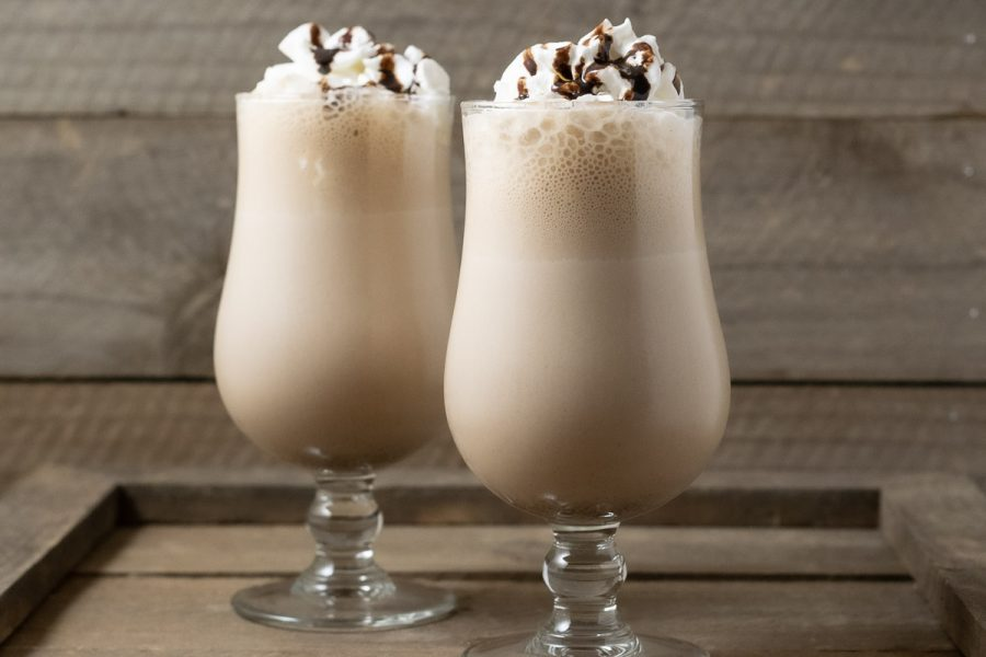 two Arby's Copycat Jamocha Shakes topped with whipped cream and chocolate drizzle