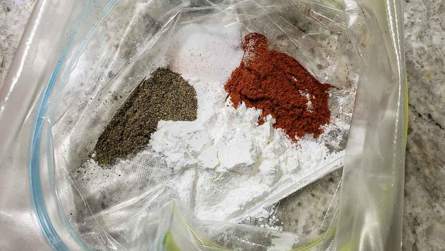 baking powder, paprika, salt, and black pepper in the bottom of a zipper baggie