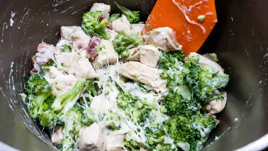 chicken, broccoli, bacon, swiss cheese added to milk mixture in a pan