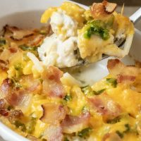 graphic with Best Jalapeño Popper Chicken Casserole Dinner For Two and has spoon lifting up some of the casserole out of the dish