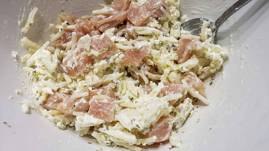 hashbrowns, chicken, garlic powder, onion powder, chives, cream cheese, salt and pepper mixed in a bowl