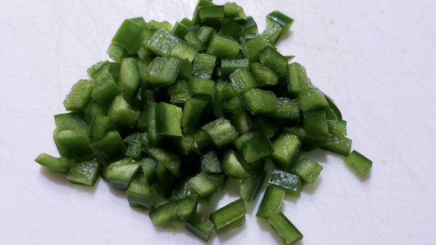 diced jalapeno peppers on a cutting board
