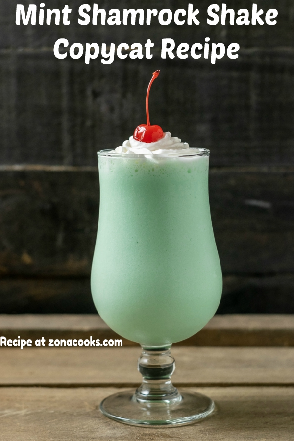 a graphic of a mint shamrock shake with whipped cream and a cherry on top