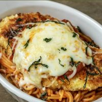 a graphic of best ever individual chicken parmesan dinner for two