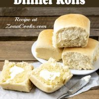 a graphic with three homemade dinner rolls stacked on a plate and one dinner roll cut open is spread with butter