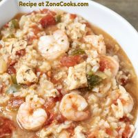 a graphic of Easy Slow Cooker Jambalaya Dinner For Two in a white dish