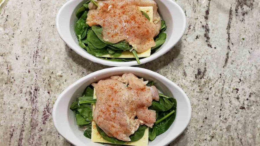 paprika sprinkled on top of stuffed chicken in two baking dishes