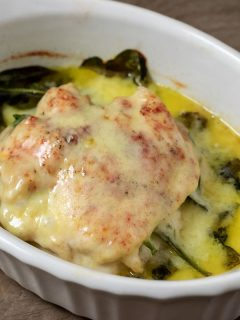 Top down view of White Cheddar and Spinach Stuffed Chicken in a baking dish
