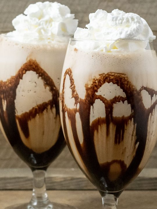 two Banana Mocha Frappe drinks topped with whipped cream