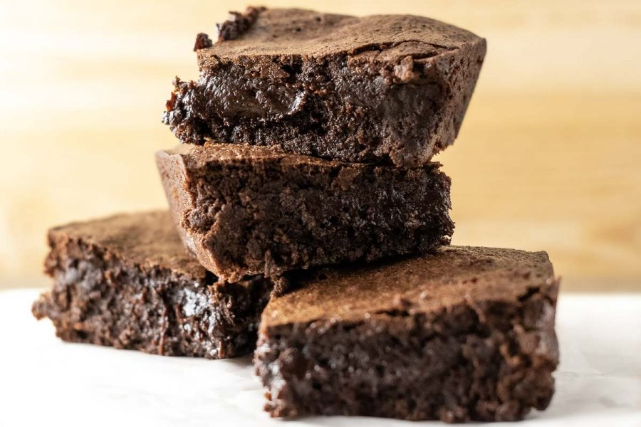 4 chewy fudge brownies stacked in a pile