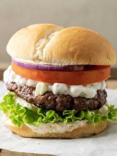 a big fat greek feta cheese burger on parchment paper