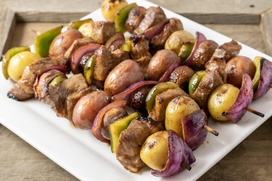 4 Easy Marinated Grilled Steak Kabobs on a square white plate