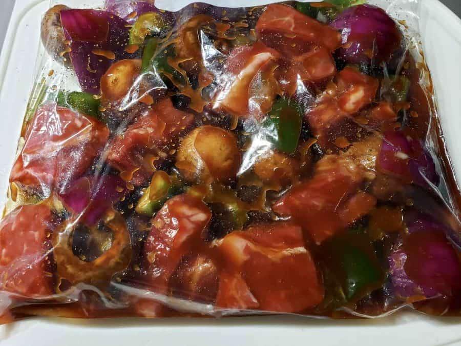 steak kabobs ingredients in a bag with marinade