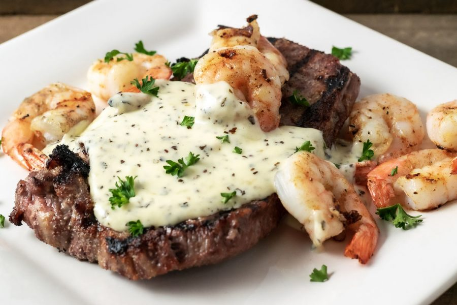 Steak and Shrimp Parmesan on a plate