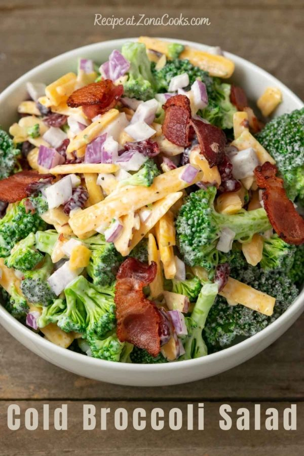 a bowl filled with broccoli, red onion, bacon, cranberries and shredded cheese coated in a white creamy sauce and text reading recipe at zonacooks.com cold broccoli salad