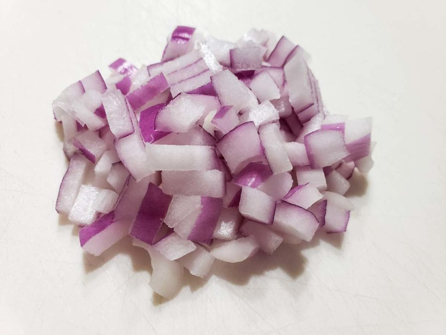 diced red onion on a cutting board